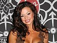 Candice Michelle had her top removed by a fellow WWE Diva on a 2007 episode of Raw. With her huge breasts, a topless Candice Michelle is quite the site to see. Candice Michelle has appeared naked on countless occasions - she was named Cyber Girl of the Week in the June 2002 issue of Playboy. Former WWE Diva Candice Michelle has a sweet pussy to say the least.