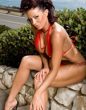 Candice Michelle looks hot in a bikini